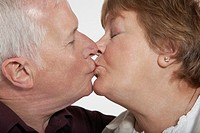 Profile of middle_aged couple kissing close_up