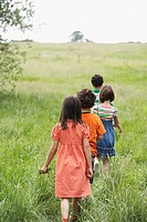 Children 7_9 walking in field