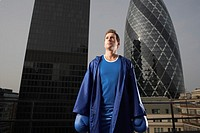 Boxer standing on downtown rooftop London England