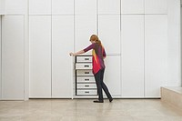 Woman looking in wardrobe in empty apartment