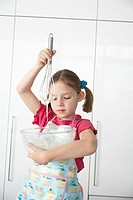 Girl 5_6 preparing food in bowl using wire whisk