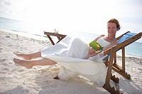 bride on deck chair at the beach