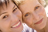 Senior woman and adult daughter smiling for the camera, outdoors (thumbnail)
