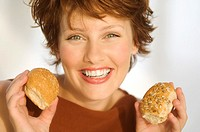 Portrait of smiling woman holding breads