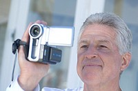 Man using camcorder