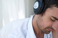 Portrait of young man listening to music with headphones