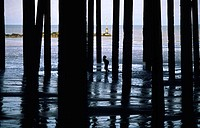 Lone Little Boy Amongst Pillars by Sea, England, United Kindom