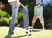 Friends playing soccer
