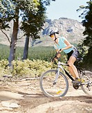 A woman mountain biking (thumbnail)