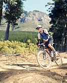 A man mountain biking on a trail