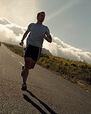 A man jogging down a desolate road