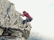 A man climbing up a mountain