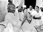 Mahatma Gandhi plying the takli spinning instrument at Dandi, Gujarat, India, April 7, 1930 - MODEL RELEASE NOT AVAILABLE