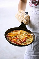 Frittata with peppers and feta in frying pan