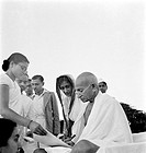 Mahatma Gandhi giving an autograph on his 75th birthday at Pune, Maharashtra, India, October 2, 1944 - MODEL RELEASE NOT AVAILABLE