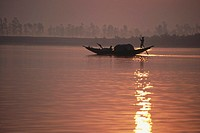 man moving boat in silhouette , indian sunderban national park , west bengal , india