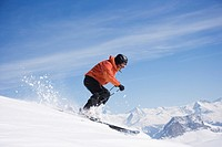Man skiing downhill on mountain