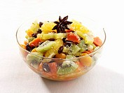 Exotic fruit salad in a glass bowl