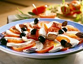 Caprese con le olive Tomatoes and mozzarella with olives