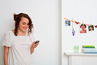 Teenage girl using cell phone