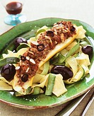Ribbon pasta with almond-stuffed courgette & olives Italy