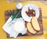 Camembert, slices of bread, anchovies and spring onions