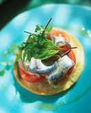 Onion confit and sardines on pastry base Not available for exclusive usages