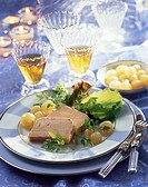 Goose liver terrine, garnished with salad and pearl onions