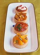 Four fruit tartlets on a platter