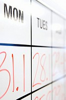 Whiteboard with numbers and days of week, close-up