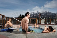 Canada, British Columbia, Whistler, four adults in hot tub