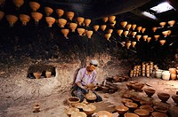 An Uyghur potter concentrating on his work in his studio in Kashgar, China