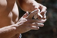 Rock Climber Taping His Fingers