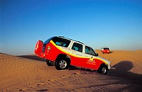 Jeep taking Tourists to Desert Adventure Dubai, United Arab Emirates, Middle East