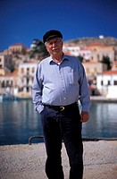 Emboreios, port, local man  Halki, Dodecanese, Greece