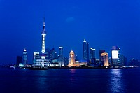 China, Shanghai, Pudong, Business District skyline seen from The Bund, night