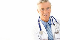 Mature male doctor with stethoscope around neck, smiling, portrait, close-up