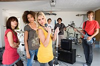 Group of teenagers 15-17 in garage band, portrait