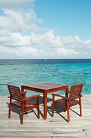 Table and chairs on tropical sea in Maldives Island, Indian Ocean