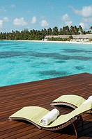 Chairs and water Villa Resorts. Maldives Island, Indian Ocean