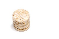 Mini rice cakes as finger foods for babies and small children, on white background