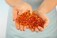 Handful Of Vitamin Oil Capsules