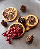 Dried orange, red berries and pine cones