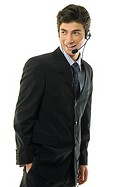 Businessman wearing headset and smiling (thumbnail)