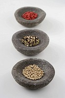 Peppercorns in stone bowls
