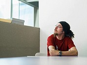 Young man sitting at desk portrait (thumbnail)