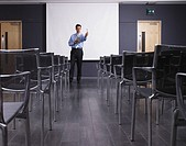 Man practicing speech in empty presentation room