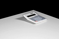 A calculator sitting on a white table
