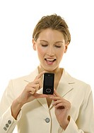 Close-up of a businesswoman showing a mobile phone