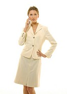 Businesswoman standing with her hand on her hip and talking on a mobile phone